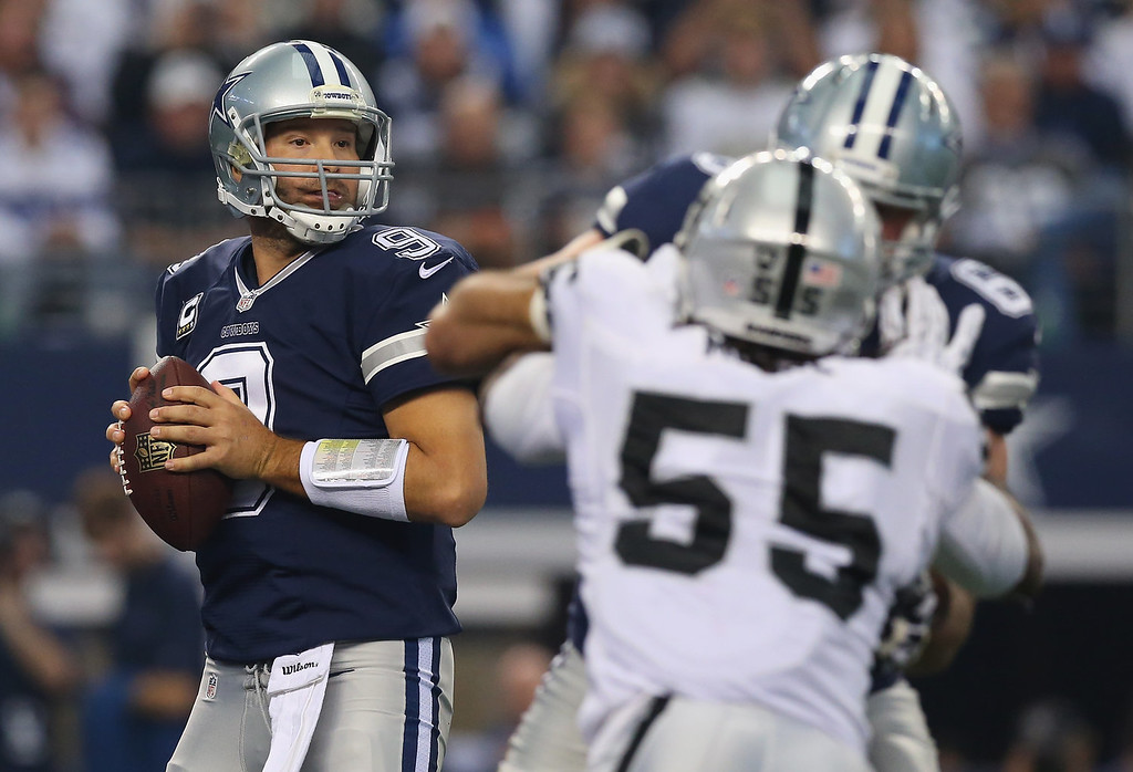 Description of . Tony Romo #9 of the Dallas Cowboys throws the ball against the Oakland Raiders at AT&T Stadium on November 28, 2013 in Arlington, Texas.  (Photo by Ronald Martinez/Getty Images)