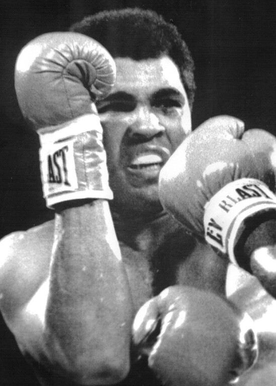 Description of . LAS VEGAS: Muhammad Ali tries to cover up under a barrage of blows by Larry Holmes. Holmes retained his heavyweight crown 10/2. 1980. Credit: UPI