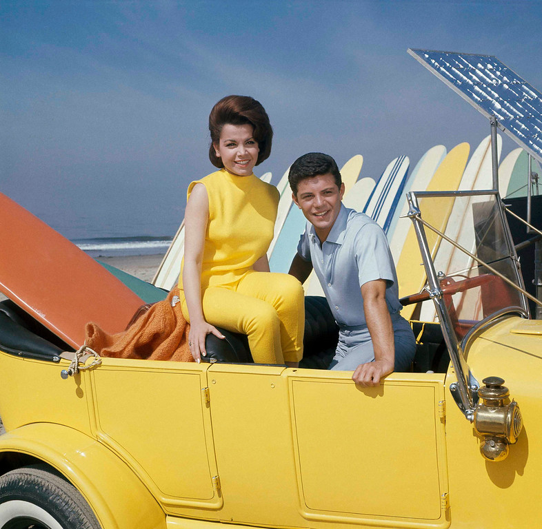 Description of . Singer Frankie Avalon with actress Annette Funicello on Malibu Beach, during filming of