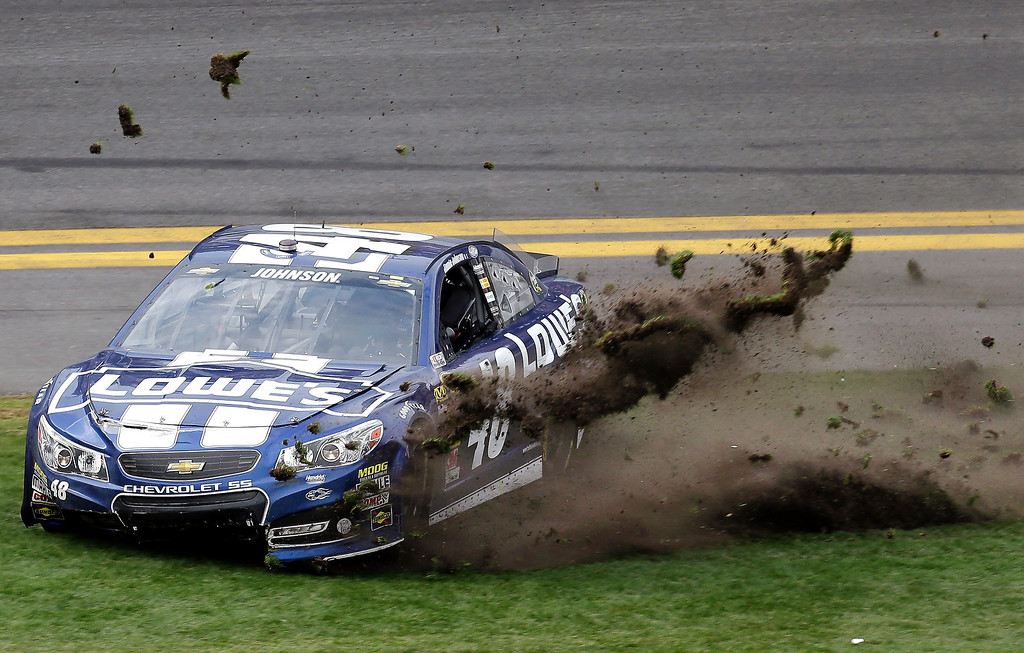 Description of . Jimmie Johnson sends grass flying as he celebrates his win in the Daytona 500 NASCAR Sprint Cup Series auto race, Sunday, Feb. 24, 2013, at Daytona International Speedway in Daytona Beach, Fla. (AP Photo/Chris O'Meara)