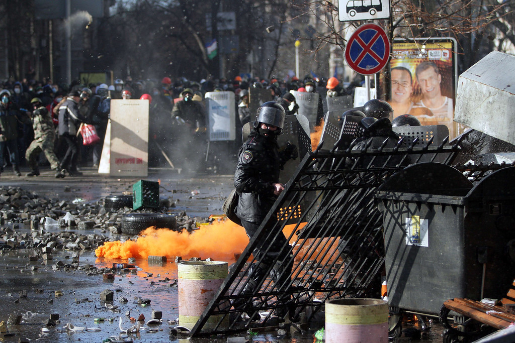 Description of . Anti-government protesters clash with riot police in central Kiev on February 18, 2014.  AFP PHOTO/ ANATOLII BOIKO/AFP/Getty Images