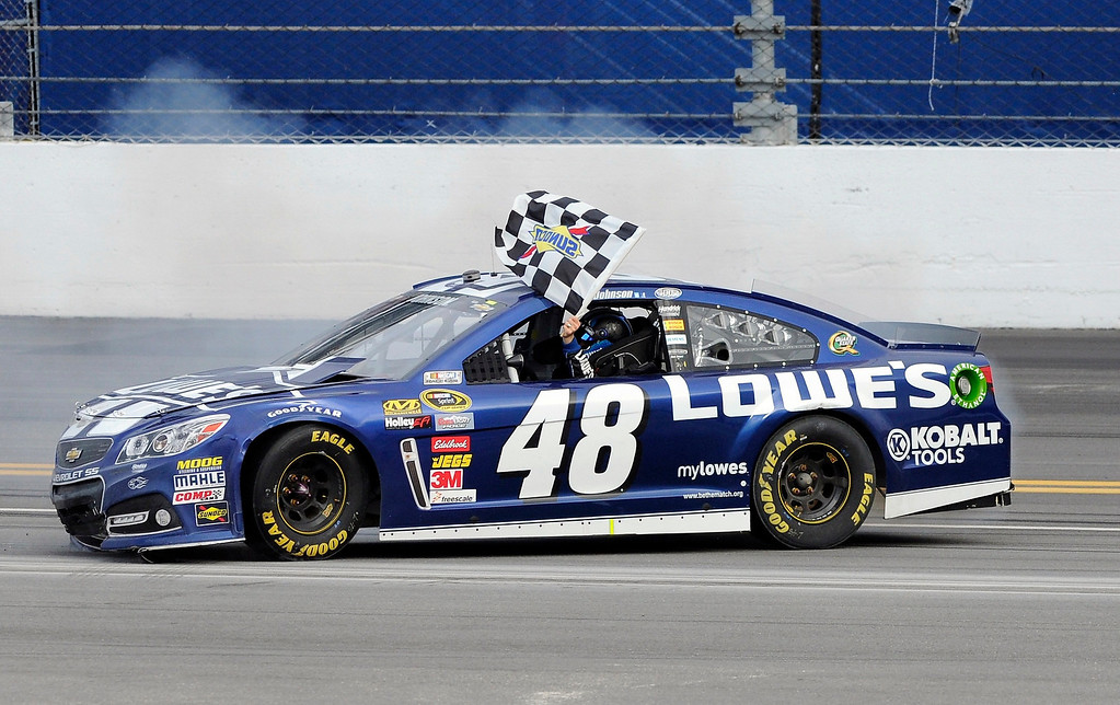 Description of . NASCAR driver Jimmie Johnson celebrates after winning the NASCAR Sprint Cup Series Daytona 500 race at the Daytona International Speedway in Daytona Beach, Florida February 24, 2013. REUTERS/Doug Murray