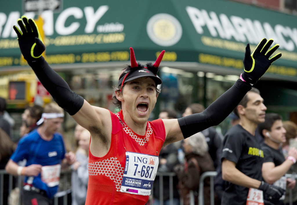 Description of . A man in a costume runs up First Avenue November 3, 2013 during the running of the New York City Marathon in New York.   DON EMMERT/AFP/Getty Images
