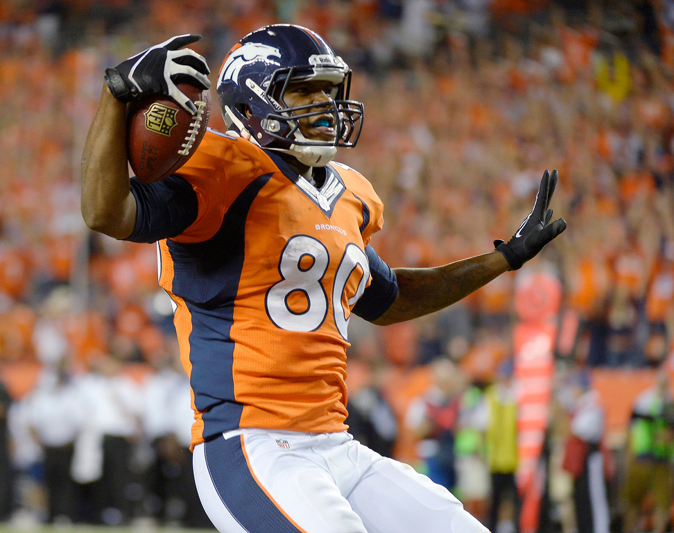 Description of . Denver Broncos tight end Julius Thomas (80) celebrates a touchdown in the second quarter. The Denver Broncos took on the Baltimore Ravens in the first game of the 2013 season at Sports Authority Field at Mile High in Denver on September 5, 2013. (Photo by Joe Amon/The Denver Post)