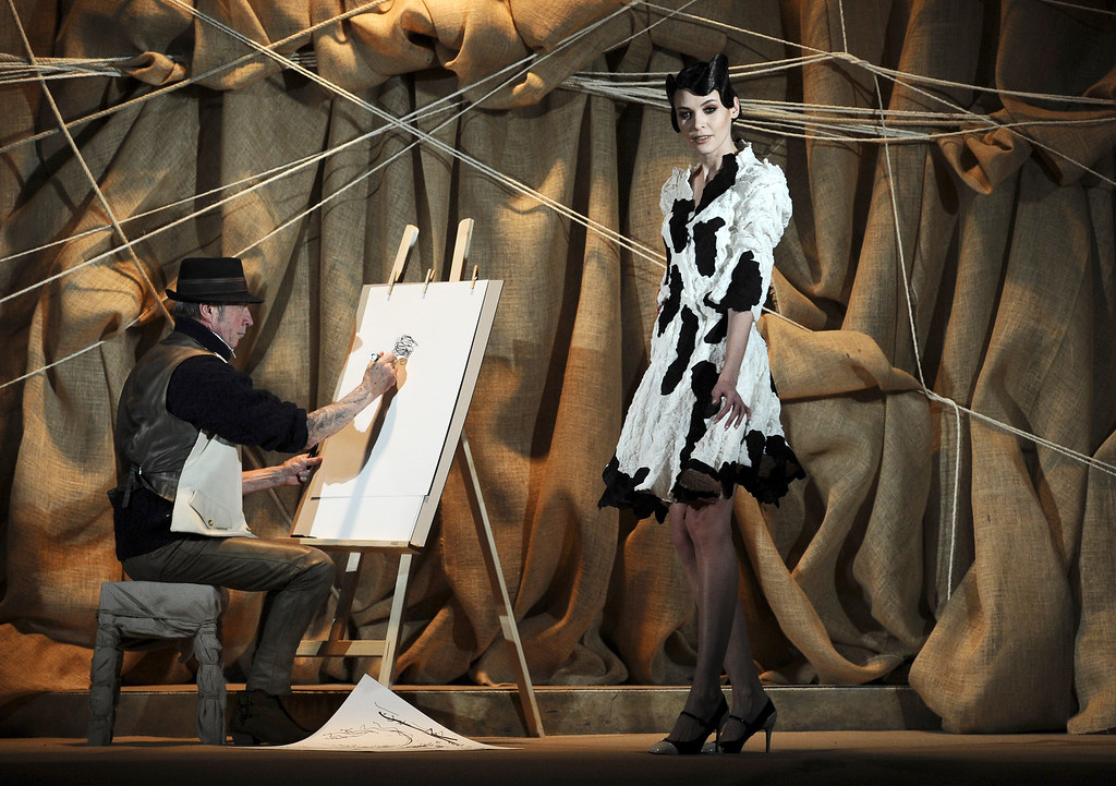 Description of . A model presents a creation for French fashion designer Frank Sorbier's Spring Summer 2013 Haute Couture fashion collection, presented in Paris, Wednesday, Jan.23, 2013. (AP Photo/Zacharie Scheurer)