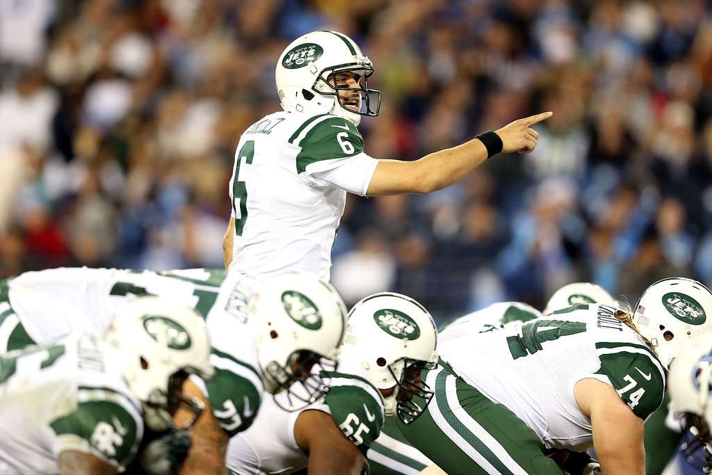 Description of . NASHVILLE, TN - DECEMBER 17:  Quarterback Mark Sanchez #6 of the New York Jets calls a play before he snaps the ball against the Tennessee Titans at LP Field on December 17, 2012 in Nashville, Tennessee.  (Photo by Andy Lyons/Getty Images)