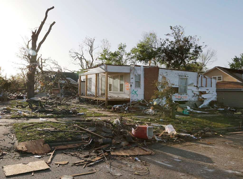 Description of . A home damaged by a tornado stands without a roof in Baxter Springs, Kan., Monday, April 28, 2014. Sunday's tornado damaged dozens of buildings and injured at least 25 people. (AP Photo/Orlin Wagner)