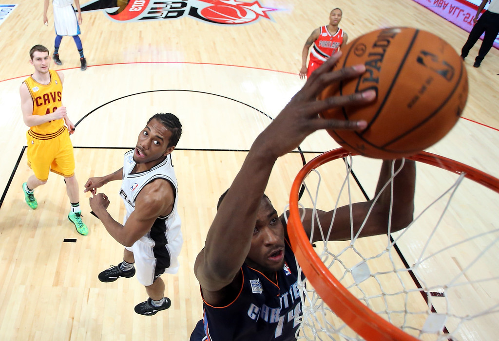 Description of . HOUSTON, TX - FEBRUARY 15:  Michael Kidd-Gilchrist #14 of the Charlotte Bobcats and Team Shaq goes up to dunk the ball in the BBVA Rising Stars Challenge 2013 part of the 2013 NBA All-Star Weekend at the Toyota Center on February 15, 2013 in Houston, Texas.   (Photo by Ronald Martinez/Getty Images)