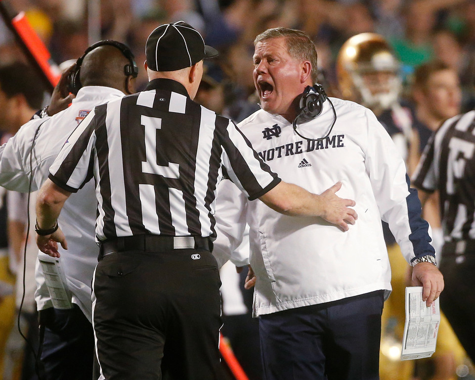 Description of . Notre Dame head coach Brian Kelly argues a call during the first half of the BCS National Championship college football game against Alabama Monday, Jan. 7, 2013, in Miami. (AP Photo/John Bazemore)