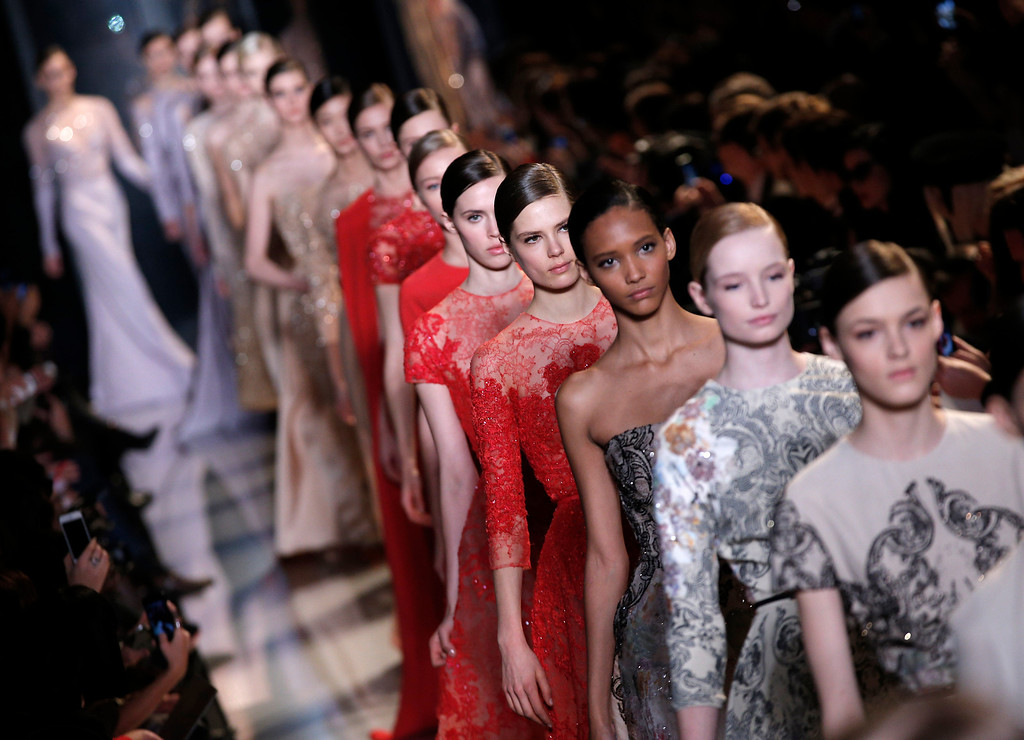 Description of . Models present creations by Lebanese fashion designer Elie Saab for his Spring Summer 2013 Haute Couture fashion collection, presented in Paris, Wednesday, Jan.23, 2013. (AP Photo/Christophe Ena)