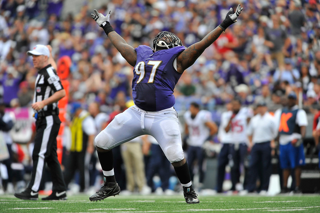 Description of . Defensive end Arthur Jones #97 of the Baltimore Ravens celebrates a sack against the Houston Texans at M&T Bank Stadium on September 22, 2013 in Baltimore, Maryland. The Ravens defeated the Texans 30-9. (Photo by Larry French/Getty Images)