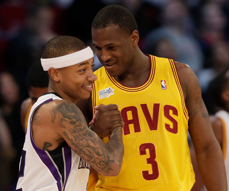 Description of . Team Chuck's Isaiah Thomas, left, of the Sacramento Kings, and Team Shaq's Dion Waiters, of the Cleveland Cavaliers, shake hands during the second half of the Rising Stars Challenge basketball game at NBA All-Star Weekend, Friday, Feb. 15, 2013, in Houston. (AP Photo/Eric Gay)