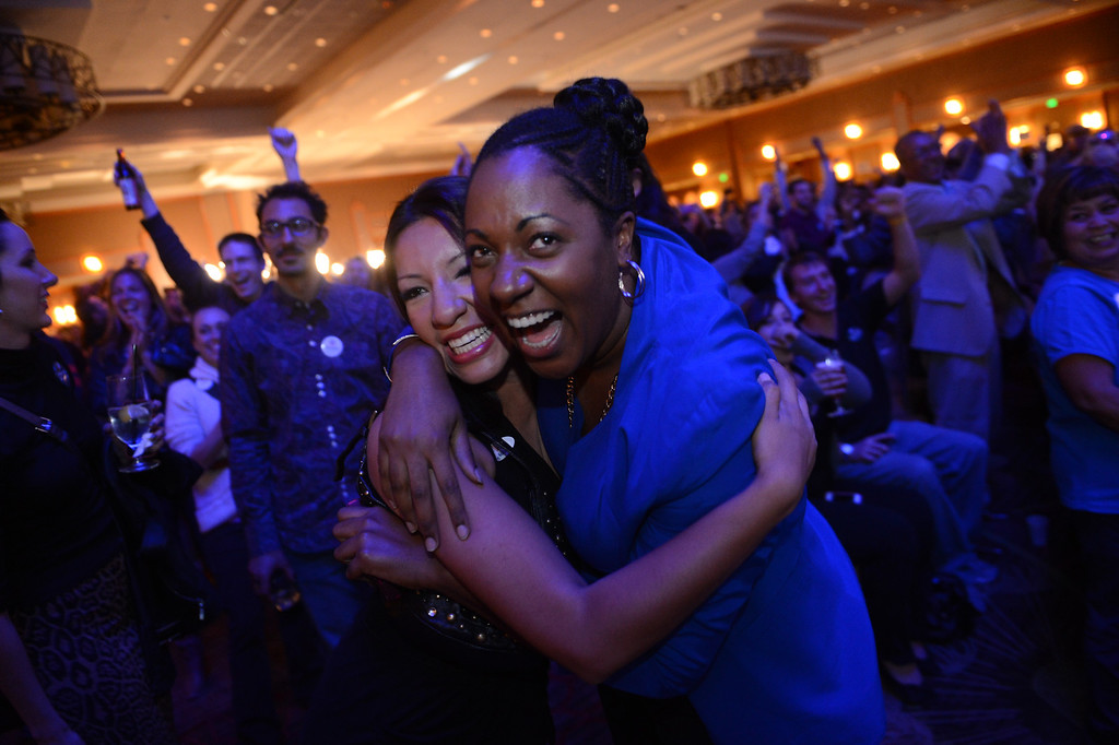 Description of . Suleka Balanos, left, and Cathryn Posey celebrate the prediction that President Barack Obama had won the election during the Colorado Democratic watch party at the Sheraton in Denver, CO, Tuesday, November 6, 2012. Craig F. Walker, The Denver Post