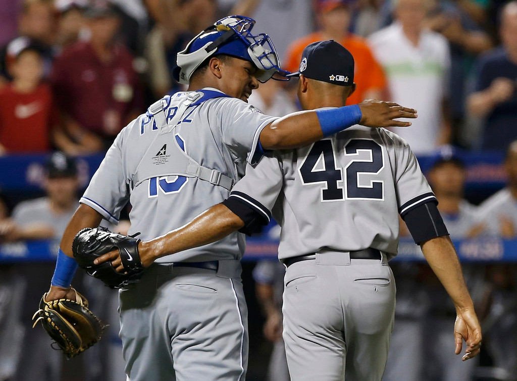 Description of . American League catcher Salvador Perez of the Kansas City Royals hugs New York Yankees pitcher Mariano Rivera after Rivera pitched the eighth inning against the National League during Major League Baseball\'s All-Star Game in New York, July 16, 2013.  REUTERS/Mike Segar