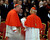 US Cardinal Timothy Dolan, left, shares a word with Cardinal John Tong Hon, of Hong Kong, as they attend a Mass for the election of a new pope celebrated by Cardinal Angelo Sodano inside St. Peter's Basilica, at the Vatican, Tuesday, March 12, 2013. (AP Photo/Andrew Medichini)
