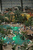 Visitors swim in a lagoon at the Tropical Islands indoor resort as cottages for overnight guests are visible behind on February 15, 2013 in Krausnick, Germany. Located on the site of a former Soviet military air base, the resort occupies a hangar built originally to house airships designed to haul long-distance cargo. Tropical Islands opened to the public in 2004 and offers visitors a tropical getaway complete with exotic flora and fauna, a beach, lagoon, restaurants, water slide, evening shows, sauna, adventure park and overnights stays ranging from rudimentary to luxury. The hangar, which is 360 metres long, 210 metres wide and 107 metres high, is tall enough to enclose the Statue of Liberty.  (Photo by Sean Gallup/Getty Images)