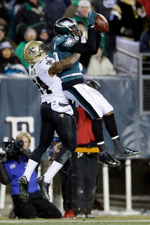 Description of . Philadelphia Eagles' DeSean Jackson pulls in a pass against New Orleans Saints' Corey White during the second half of an NFL wild-card playoff football game, Saturday, Jan. 4, 2014, in Philadelphia. (AP Photo/Michael Perez)