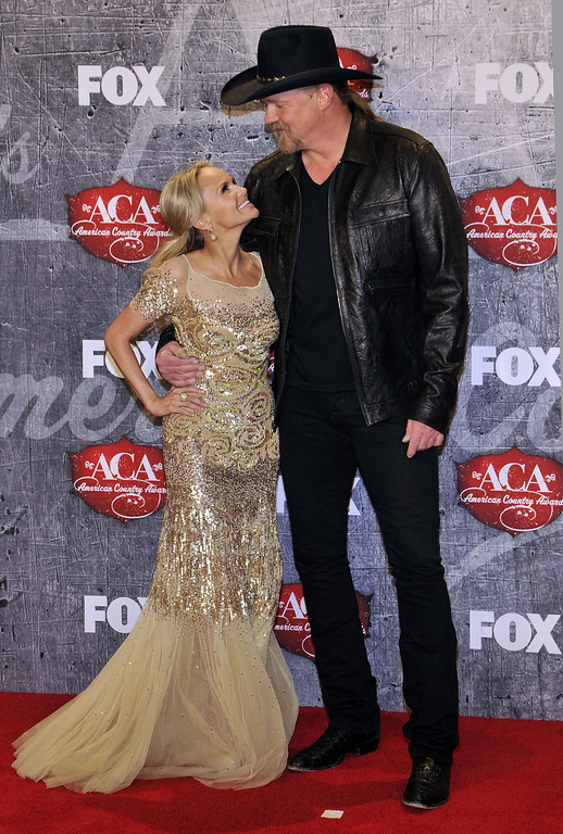 Description of . From left, singer/actress Kristin Chenoweth poses with recording artist Trace Adkins in the press room backstage at the American Country Awards on Monday, Dec. 10, 2012, in Las Vegas. (Photo by Jeff Bottari/Invision/AP)