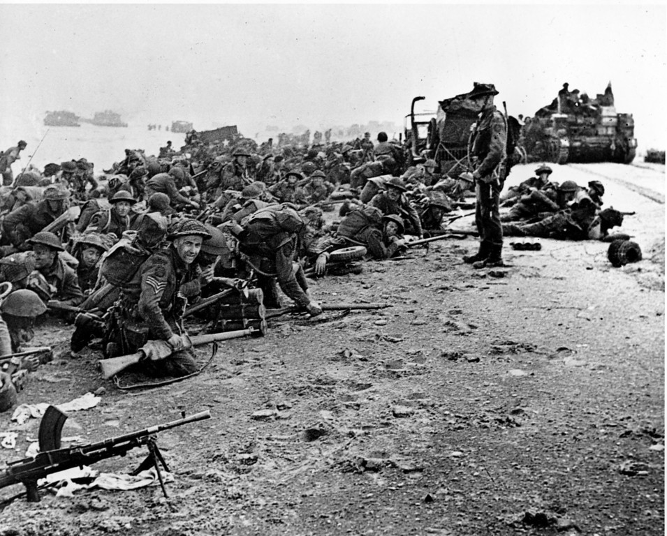 Description of . After landing at the shore, these British troops wait for the signal to move forward, during the initial Allied landing operations in Normandy, France, June 6, 1944. (AP Photo)