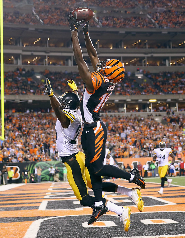 Description of . A.J. Green #18 of the Cincinnati Bengals reaches for a pass that would fall incomplete during the NFL game against the Pittsburgh Steelers at Paul Brown Stadium on September 16, 2013 in Cincinnati, Ohio.  (Photo by Andy Lyons/Getty Images)