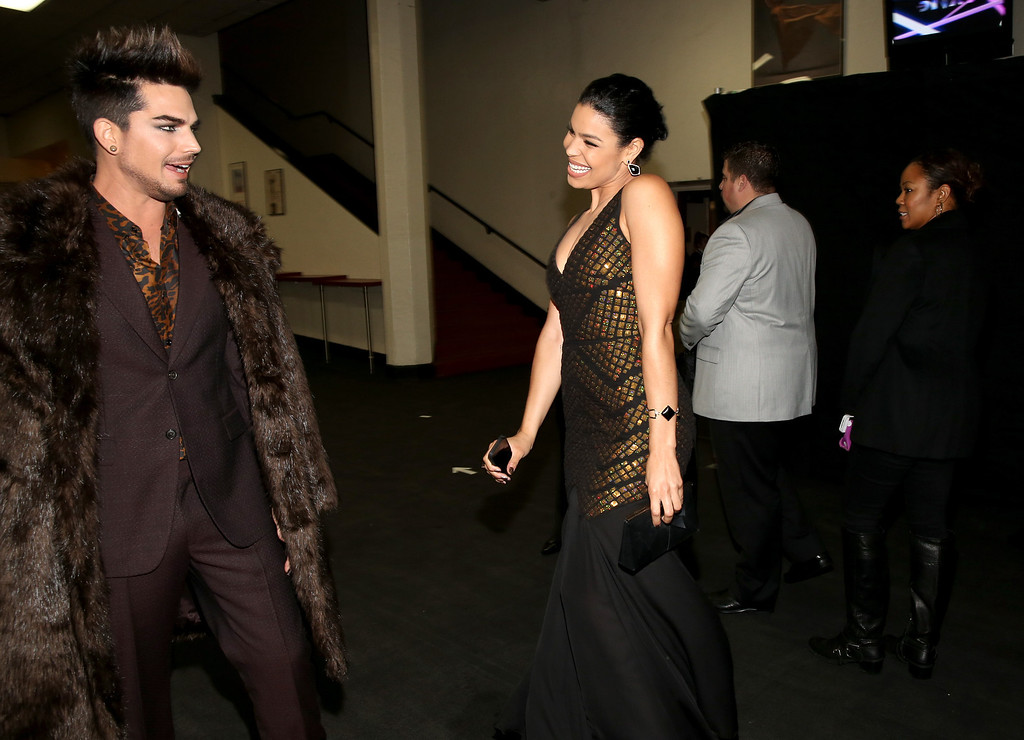 Description of . LOS ANGELES, CA - DECEMBER 16:  (L-R) Host Adam Lambert and singer Jordin Sparks attend