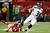Russell Wilson #3 of the Seattle Seahawks escapes the tackle of  Kroy Biermann #71 of the Atlanta Falcons in the second quarter of the NFC Divisional Playoff Game at Georgia Dome on January 13, 2013 in Atlanta, Georgia.  (Photo by Kevin C. Cox/Getty Images)