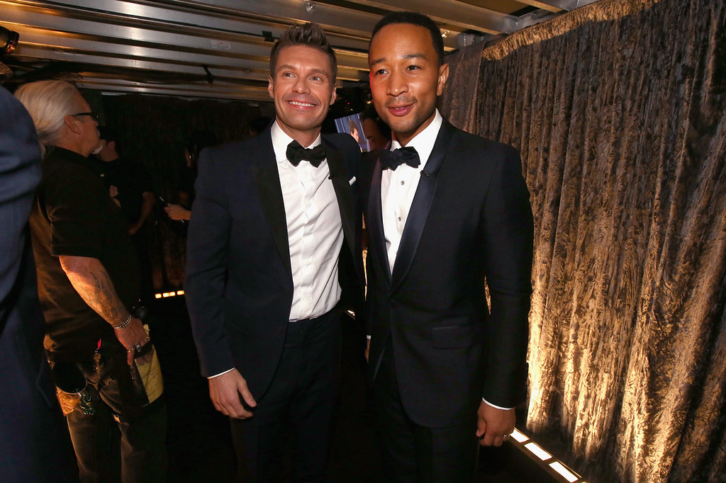 Description of . TV Personality Ryan Seacrest and singer John Legend attend the 56th GRAMMY Awards at Staples Center on January 26, 2014 in Los Angeles, California.  (Photo by Christopher Polk/Getty Images)