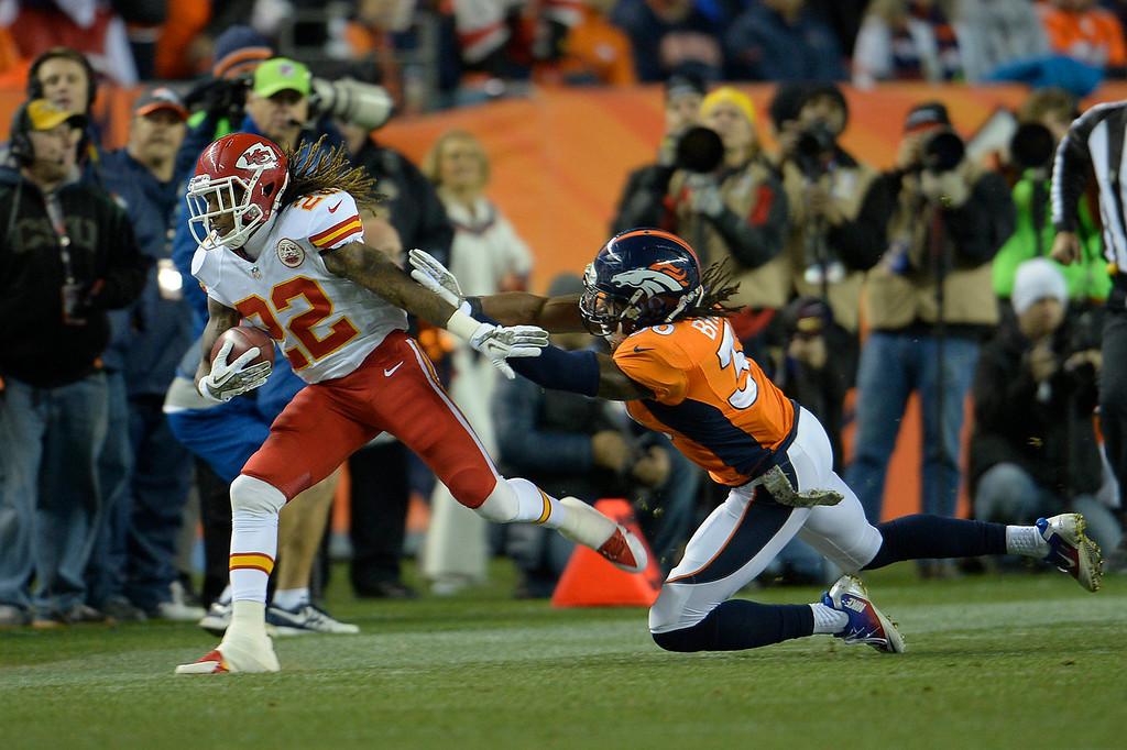 Description of . Kansas City Chiefs wide receiver Dexter McCluster (22) is pushed out of bounds in the first quarter. The Denver Broncos take on the Kansas City Chiefs at Sports Authority Field at Mile High in Denver on November 17, 2013. (Photo by Joe Amon/The Denver Post)