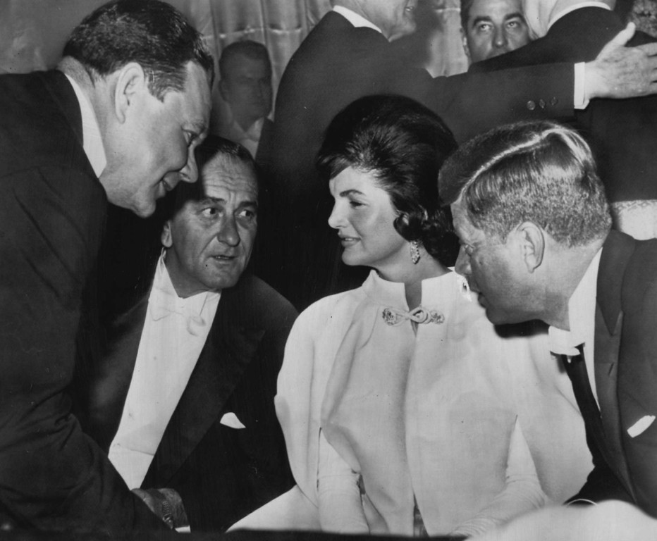 Description of . Rep. Hale Boggs, D-La., stops to chat with the president, first lady and vice president at the Mayflower Hotel, one of five ball sites scattered around Washington on Jan. 22, 1961.
