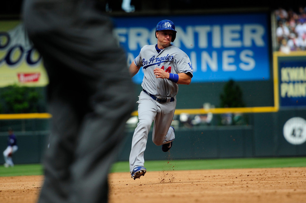 Description of . Mark Ellis (14) of the Los Angeles Dodgers rounds the bases against the Colorado Rockies during the action in Denver on Monday, September 2, 2013. The Colorado Rockies hosted the Los Angeles Dodgers at Coors Field.   (Photo by AAron Ontiveroz/The Denver Post)