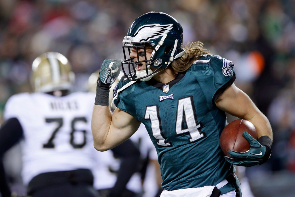 Description of . Philadelphia Eagles' Riley Cooper celebrates after scoring a touchdown during the first half of an NFL wild-card playoff football game against the New Orleans Saints, Saturday, Jan. 4, 2014, in Philadelphia. (AP Photo/Michael Perez)