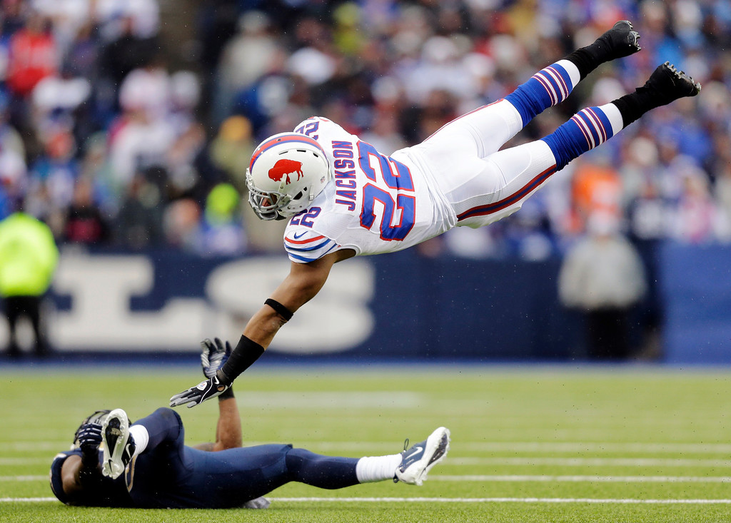 Description of . Buffalo Bills running back Fred Jackson (22) goes airborne after being hit by St. Louis Rams free safety Quintin Mikell during the second half of an NFL football game, Sunday, Dec. 9, 2012, in Orchard Park, N.Y. (AP Photo/Gary Wiepert)