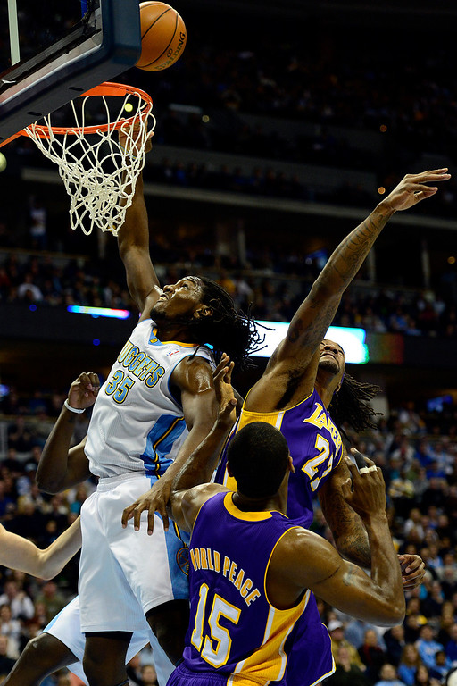 Description of . Denver Nuggets small forward Kenneth Faried (35) tips the ball in on the Nuggets' fourth attempt against the Los Angeles Lakers during the first half at the Pepsi Center on Wednesday, December 26, 2012. AAron Ontiveroz, The Denver Post