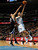 Denver Nuggets guard Evan Fournier, right, goes up for a shot past Sacramento Kings guard Francisco Garcia during the fourth quarter of the Nuggets' 121-93 victory in an NBA basketball game in Denver on Saturday, Jan. 26, 2013. (AP Photo/David Zalubowski)