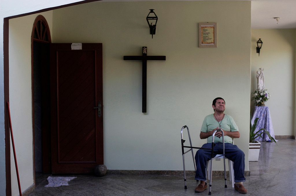 Description of . Paulo Fernandes, who is homeless, sits in a house belonging to Franciscan fraternity O Caminho, where he has been living for two months, in the Campo Grande neighbourhood of Rio de Janeiro April 16, 2013. O Caminho (The Way), are a group of Franciscan monks and nuns who help the homeless on the streets of Rio de Janeiro. They consider the election of Pope Francis, the first pontiff to take the name of St Francis of Assisi, to be a confirmation of their beliefs in poverty and simplicity. In July, Pope Francis will visit Rio de Janeiro in his first international trip since assuming the papacy. Picture taken April 16, 2013. REUTERS/Ricardo Moraes