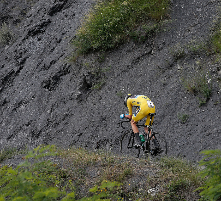 Description of . Stage winner Christopher Froome of Britain, wearing the overall leader's yellow jersey, rides during the seventeenth stage of the Tour de France cycling race an individual time trial over 32 kilometers (20 miles) with start in Embrun and finish in Chorges, France, Wednesday July 17, 2013. (AP Photo/Christophe Ena)