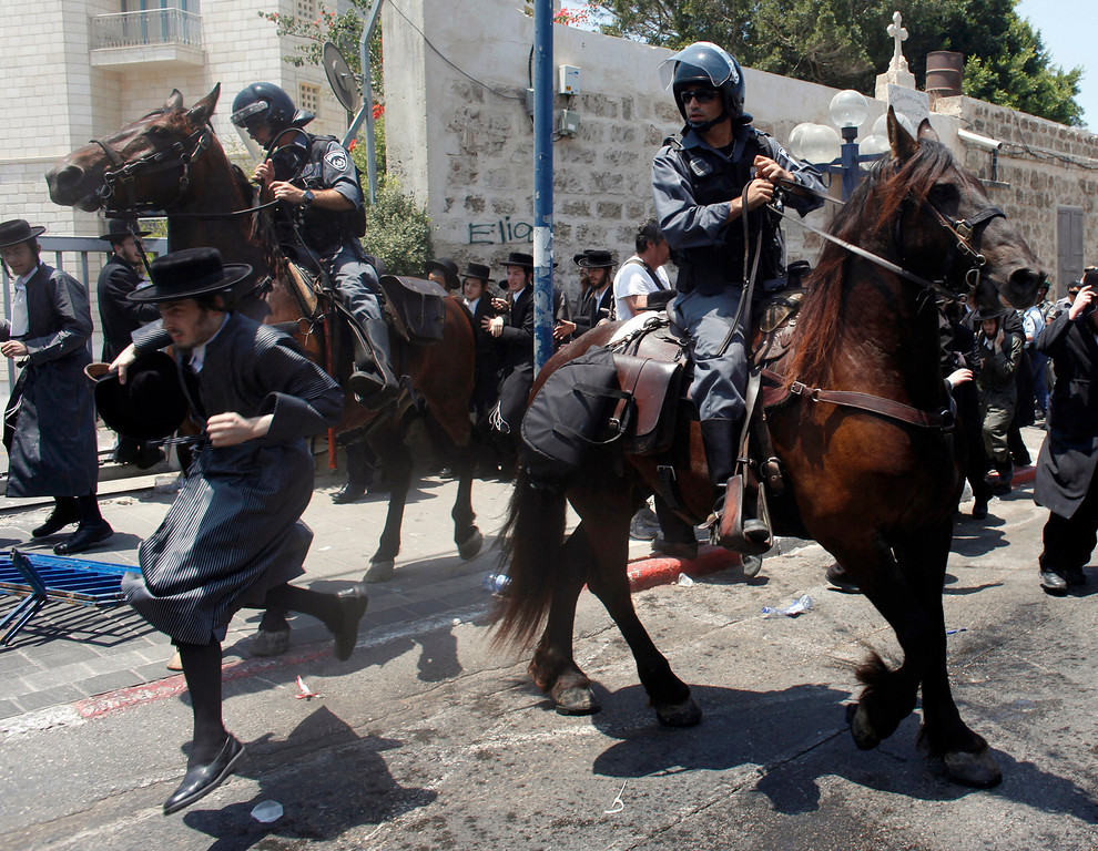 Description of . Mounted Israeli police officers try to disperse ultra-Orthodox Jews during a protest in Jaffa, just south of central Tel Aviv June 16, 2010. REUTERS/Nir Elias