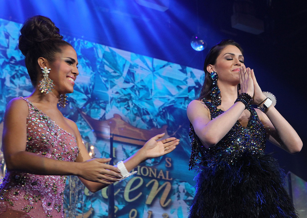 Description of . Marcelo Ohio of Brazil, right, reacts to winning the crown next to Shantell D'Marco, left, of the US. who took 1st runner up spot, at the Miss International Queen 2013 transgender beauty pageant in Pattaya, southeastern Thailand,  Friday, Nov. 1, 2013. (AP Photo/Apichart Weerawong)