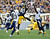 Plaxico Burress #80 of the Pittsburgh Steelers makes a catch between the defense of Quentin Jammer #23 and Takeo Spikes #51 of the San Diego Chargers on December 9, 2012 at Heinz Field in Pittsburgh, Pennsylvania.  (Photo by Joe Sargent/Getty Images)