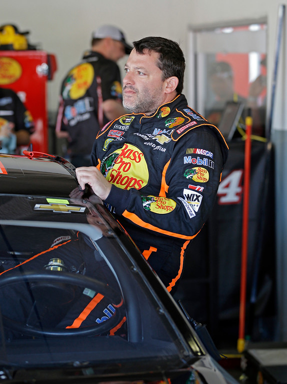. Tony Stewart climbs in his car preparing to go out on the track during practice for the NASCAR Daytona 500 Sprint Cup Series auto race at Daytona International Speedway, Wednesday, Feb. 20, 2013, in Daytona Beach, Fla. (AP Photo/John Raoux)