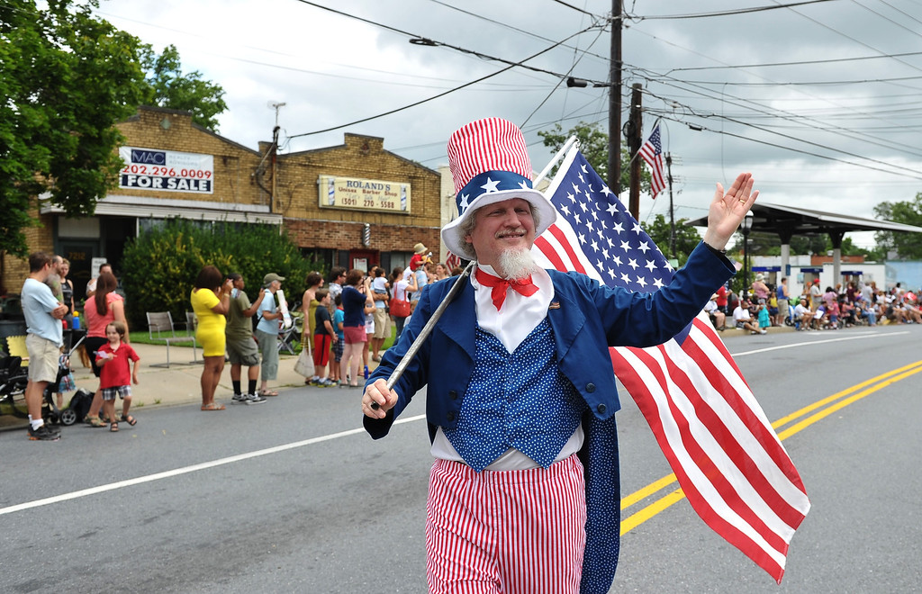 Description of . A man dressed as Uncle Sam takes part in the Independence Day parade in Takoma Park, Maryland on July 4, 2013. Independence Day celebrates the declaration of independence from Britain in 1776. MANDEL NGAN/AFP/Getty Images