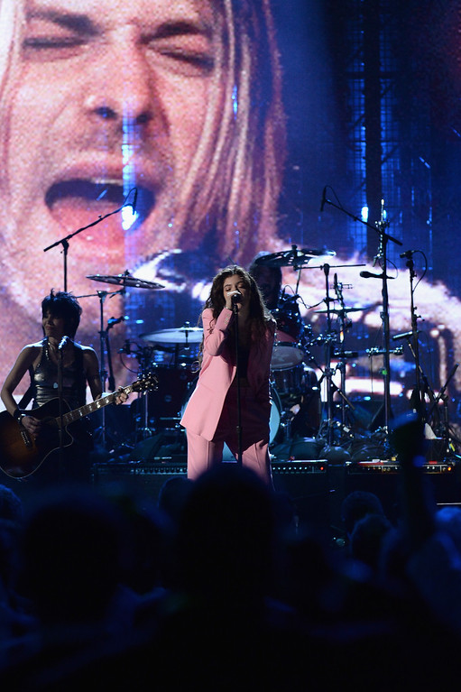 Description of . Musicians Joan Jett, Lorde and Dave Grohl perform onstage at the 29th Annual Rock And Roll Hall Of Fame Induction Ceremony at Barclays Center of Brooklyn on April 10, 2014 in New York City.  (Photo by Larry Busacca/Getty Images)