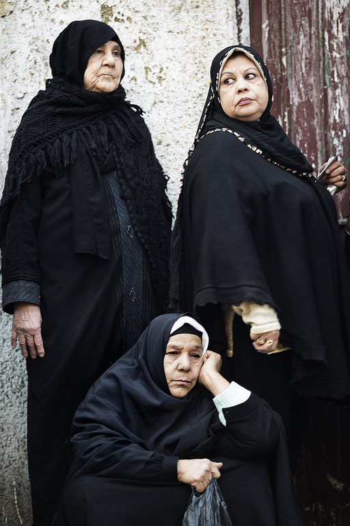 Description of . Egyptian women wait outside a polling station to cast their votes on a new constitution supported by the ruling Islamists but bitterly contested by a secular-leaning opposition on December 15, 2012 in Cairo. President Mohamed Morsi cast his ballot in a polling station close to his presidential palace in the capital, state television showed, but he made no comment to the media. MARCO LONGARI/AFP/Getty Images