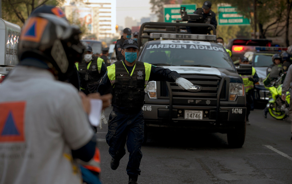 Description of . A Mexican Federal Police truck heads to the skyscraper that houses the headquarters of state-owned Mexican oil giant Pemex, following a blast inside the building in Mexico City on January 31, 2013. An explosion rocked the skyscraper, leaving up to now 14 dead and 100 injured people, according to official sources.   YURI CORTEZ/AFP/Getty Images