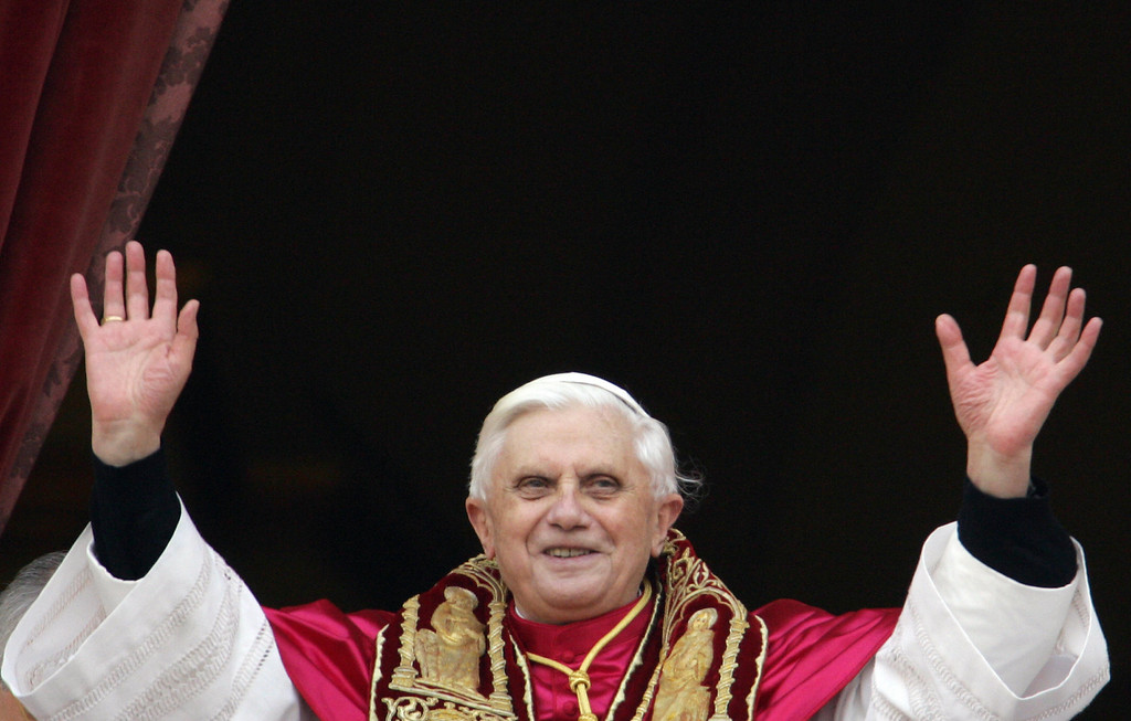 Description of . Germany's Joseph Ratzinger, the new Pope Benedict XVI,  appears at the window of St Peter's Basilica's main balcony after being elected the 265th pope of the Roman Catholic Church 19 April 2005 at the Vatican City.  PATRICK HERTZOG/AFP/Getty Images
