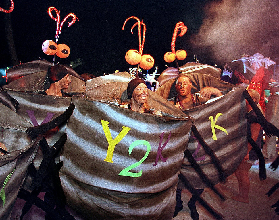 "Description of . Contestants costumed as ""Y2K Bugs\"" dance and prance during the Pier House Pretenders in Paradise Costume Competition on October 29, 1999 as part of Key West\'s Fantasy Fest. With a theme of \""www.warptime.com,\"" the 10-day wacky extravaganza culmi"