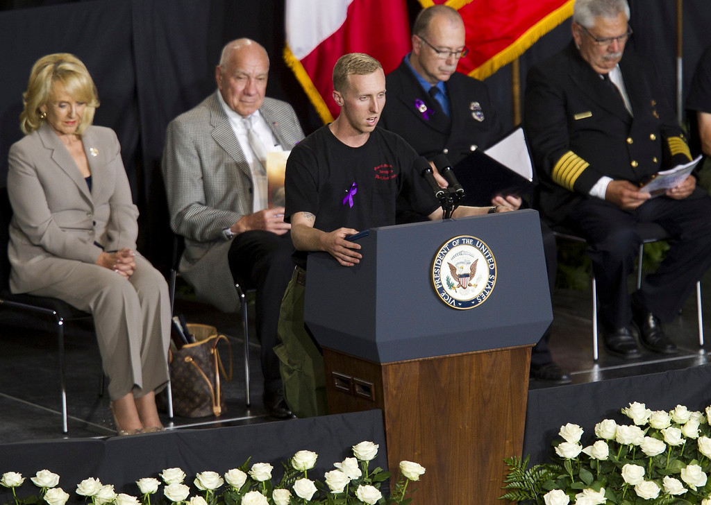 Description of . Brendan McDonough recites the Hotshots Prayer during a memorial service at Tim's Toyota Center in Prescott Valley, Arizona July 9, 2013.    REUTERS/Michael Chow/Pool