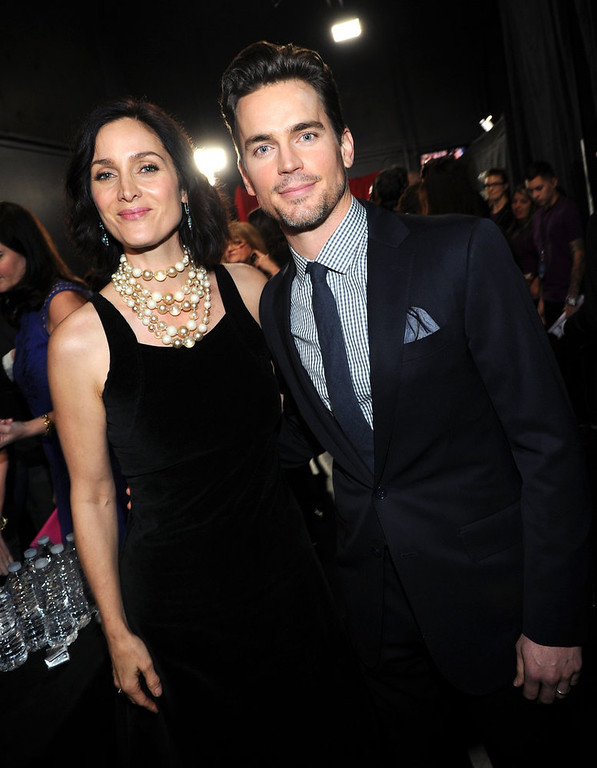 Description of . (L-R) Actors Carrie-Anne Moss and Matthew Bomer attend the 39th Annual People's Choice Awards at Nokia Theatre L.A. Live on January 9, 2013 in Los Angeles, California.  (Photo by Michael Buckner/Getty Images for PCA)