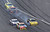 Marcos Ambrose drives the #9 Stanley Ford as smoke flies from behind after an incident in the NASCAR Sprint Cup Series Budweiser Duel 2 at Daytona International Speedway on February 21, 2013 in Daytona Beach, Florida.  (Photo by Sam Greenwood/Getty Images)
