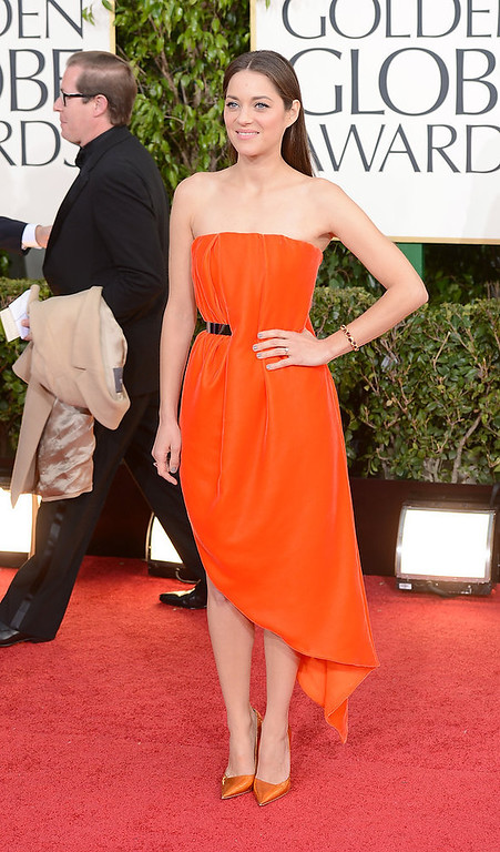 Description of . Actress Marion Cotillard arrives at the 70th Annual Golden Globe Awards held at The Beverly Hilton Hotel on January 13, 2013 in Beverly Hills, California.  (Photo by Jason Merritt/Getty Images)
